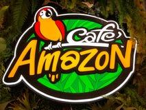 Tienda del Amazonas del café, logotipo de la bebida del Amazonas del café fotos de archivo libres de regalías