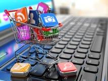 Tienda del software del ordenador portátil Iconos de Apps en carro de la compra Foto de archivo