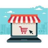 Tienda en línea. Ordenador portátil con el toldo Imágenes de archivo libres de regalías