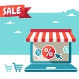 Tienda en línea. Ordenador portátil con el toldo Imagen de archivo