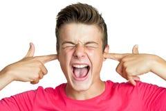 Tiener blokkerende oren met vingers Stock Afbeeldingen
