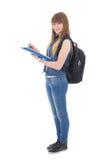 Tiener die die in notitieboekje schrijven op wit wordt geïsoleerd Royalty-vrije Stock Foto
