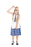 Tiener die een eenvormige school en glazen dragen die laptop houden. Meisje die zijn hoofd met een pen krassen. Stock Afbeelding