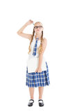 Tiener die een eenvormige school en glazen dragen die laptop houden. Meisje die zijn hoofd met een pen krassen. Royalty-vrije Stock Foto's