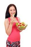 Tiener die salade eten Stock Fotografie