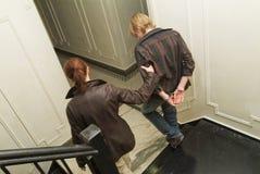Tiener die wordt gearresteerd Stock Afbeelding