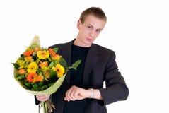 Tiener met boeket van bloemen stock afbeelding