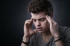Tiener met hoofdpijn Stock Foto