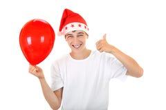 Tiener met Rode Ballon Stock Afbeeldingen