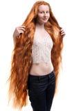 Tiener met uiterst lang rood haar Stock Foto's