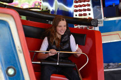 Tiener op carrousel Stock Afbeelding