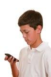 Tiener op cellulaire telefoon (cellphone) royalty-vrije stock foto's
