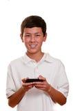 Tiener op cellulaire telefoon die (cellphone) texting Stock Afbeeldingen
