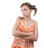 Tiener in oranje kleding over wit Stock Foto's