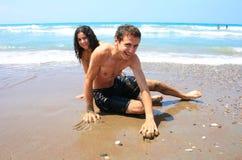 Tienerjaren op het strand Stock Foto