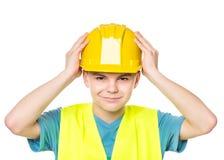Tienerjongen in bouwvakker stock afbeeldingen