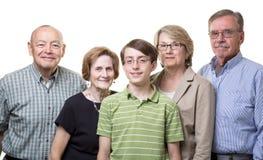 Tienerkleinzoon met grootouders Stock Foto