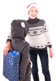 2 tienermeisje met een Nieuwjaargift Stock Foto's