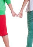 Tieners die handen houden tegen witte achtergrond Royalty-vrije Stock Foto