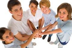 Tieners met handen samen Stock Foto's
