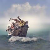 Tiere in einem Boot Stockfotos