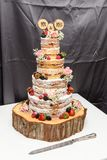 Naked wedding Cake with fresh berries, fruit and flowers Stock Photos