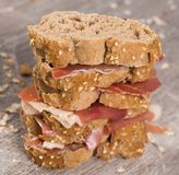 Tiered sandwich made with with rye bread and ham. Delicious tiered sandwich made with with rye bread and ham Stock Photography