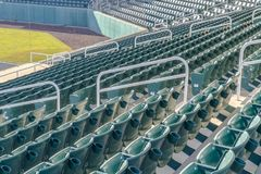 Tiered seating at a sports arena on a sunny day royalty free stock photography