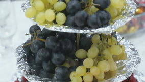 Tiered stand for fruit-filled, hawthorn and grapes stock video footage