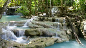 Tiered waterfall. Beautiful tiered waterfall and turquoise pools in a tropical rainforest. Erawan National Park, Kanchanaburi Province Thailand Royalty Free Stock Photo