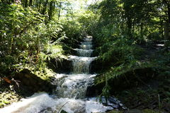 Tiered waterfall. Small artificial waterfall in Haigh Hall Country park Stock Images