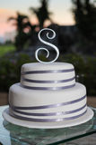 Tiered wedding cake outdoors Stock Photo