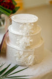 Tiered white wedding box for envelopes and post cards at a banqu Stock Photos