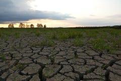 Tierra agrietada de la sequía Foto de archivo