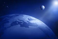 Tierra con la luna y el sol Foto de archivo libre de regalías