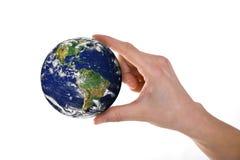 Tierra con la mano Fotos de archivo