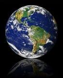 Tierra con la reflexión Imagenes de archivo