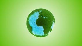 Tierra de la hierba verde con agua almacen de metraje de vídeo