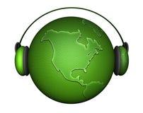 Tierra de la música con los auriculares Fotografía de archivo libre de regalías