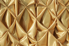 Tierra de oro de la parte posterior de la textura de la tela Fotografía de archivo