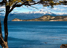 Tierra del Fuego, Argentina. Snow-capped mountains meet water at the Beagle Channel, Tierra del Fuego National Park, Ushuaia,Argentina, a landscape at the end of Stock Photo