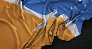 Tierra del Fuego Flag Wrinkled On framför mörk bakgrund 3D Royaltyfria Bilder