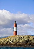 Tierra del Fuego Lighthouse, Argentina. Red and White Lighthouse in the Beagle Channel, in Tierra del Fuego near Ushuaia, Argentina, at the end of the world Royalty Free Stock Photos