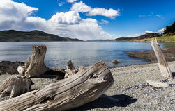 Tierra del Fuego's Lago Roca with snow capped mountains from Chile Stock Photo
