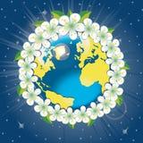 Tierra del planeta con la órbita de los flovers de la primavera. Visión para Foto de archivo