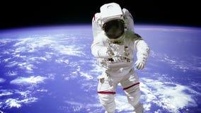 Tierra del planeta de la gente del espacio exterior del astronauta del astronauta metrajes