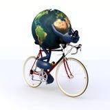 Tierra del planeta que monta una bici que compite con Imagen de archivo libre de regalías