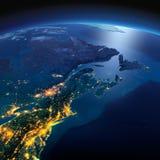 Tierra detallada Los E.E.U.U. de nordeste y Canad? del este en una noche iluminada por la luna imágenes de archivo libres de regalías