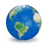 Tierra formada del balón de fútbol Imagen de archivo libre de regalías