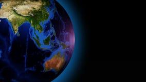 Tierra giratoria con el resplandor azul externo, 3d animación colocada inconsútil, resplandor externo azul libre illustration